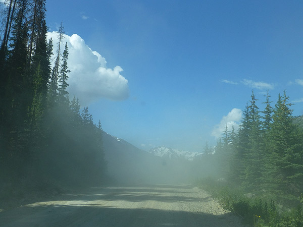 Dust cloud from logging truck